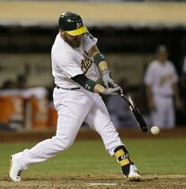 Oakland Athletics' Derek Norris breaks his bat on a pitch from Texas Rangers' Derek Holland in the sixth inning of a baseball game Wednesday, Sept. 17, 2014, in Oakland, Calif. (AP Photo/Ben Margot)