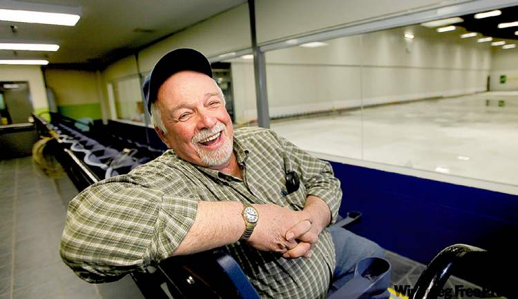 Former mayor Gord Arbuckle, at the curling rink in an old Winnipeg Arena seat, was among the 'blockheads' who laid cinder blocks.