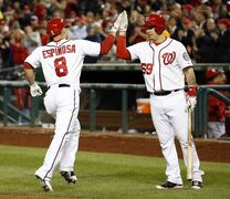 Washington Nationals' Danny Espinosa (8) celebrates his solo home run with Jose Lobaton during the sixth inning of a baseball game against the San Diego Padres at Nationals Park, Thursday, April 24, 2014, in Washington. (AP Photo/Alex Brandon)