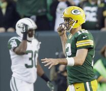 Green Bay Packers' Aaron Rodgers celebrates after throwing a touchdown pass during the second half of an NFL football game against the New York Jets Sunday, Sept. 14, 2014, in Green Bay, Wis. (AP Photo/Tom Lynn)