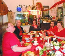 These West End revellers celebrated the Chinese New Year with a red-themed potluck supper.