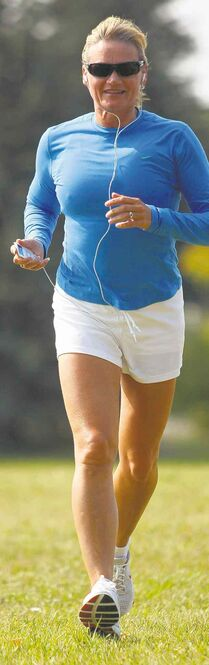 Helen Vanderburg runs with her Nike+iPod Sport Kit, which lets her listen to music while monitoring her workouts.