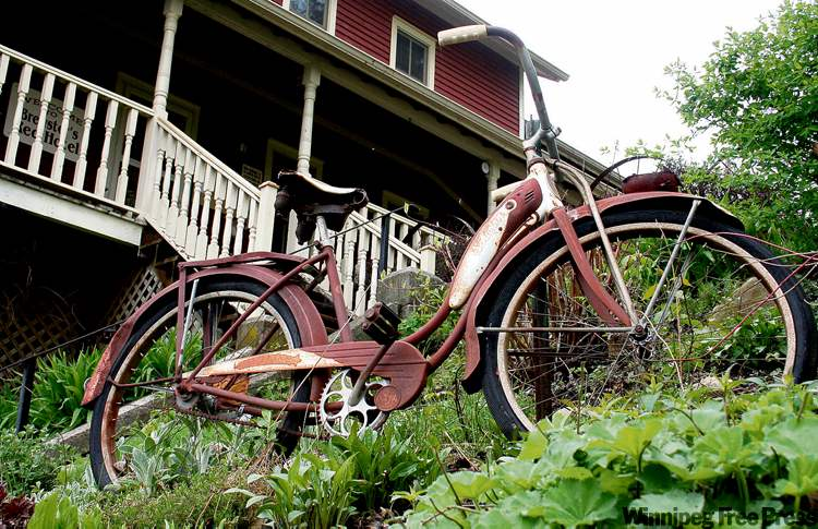 A bicycle in front of Brewster's Red Hotel in Lanesboro, MN.