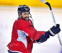 Winnipeg Jets' Dustin Byfuglien is enthusiastic before practice starts at the MTS Centre last week.