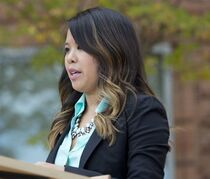 FILE - In this Oct. 24, 2014, file photo, Patient Nina Pham speaks outside of National Institutes of Health (NIH) in Bethesda, Md. A Texas district judge on Monday, April 20, 2015, put on hold a hospital operator's efforts to seek a worker's compensation claim for Pham who contracted Ebola while caring for the first U.S. patient to succumb to the deadly disease. (AP Photo/Pablo Martinez Monsivais, File)