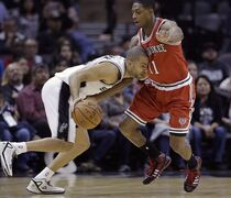 San Antonio Spurs' Tony Parker (9) is defended by Milwaukee Bucks' Brandon Knight (11) during the first half of an NBA basketball game, Sunday, Jan. 25, 2015, in San Antonio. (AP Photo/Eric Gay)