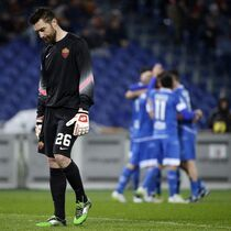 Roma goalkeeper Morgan De Sanctis, left, walks by as Empoli's players celebrating after their teammate Massimo Maccarone scored during a Serie A soccer match between Roma and Empoli, at Rome's Olympic Stadium, Saturday, Jan. 31, 2015. (AP Photo/Andrew Medichini)