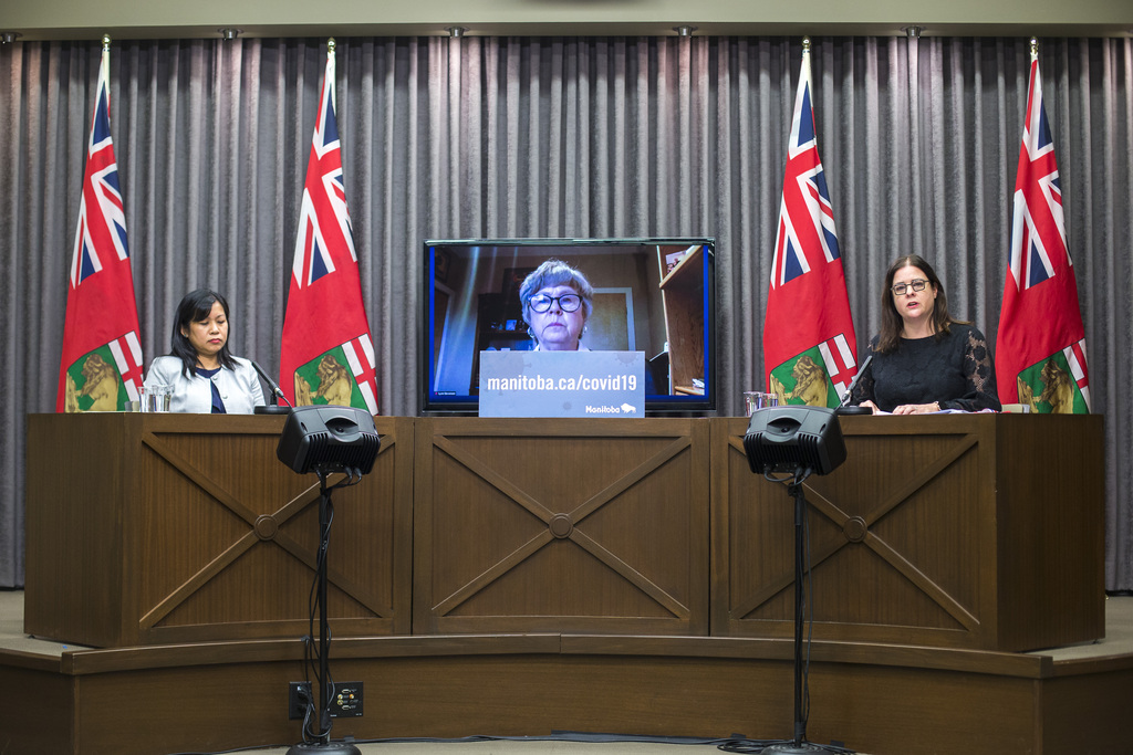 Winnipeg Regional Health Authority chief health operations officer Gina Trinidad (from left), external reviewer Dr. Lynn Stevenson, and Health Minister Heather Stefanson release the results of the Maples Long Term Care Home review on Thursday. (Mikaela MacKenzie / Winnipeg Free Press)
