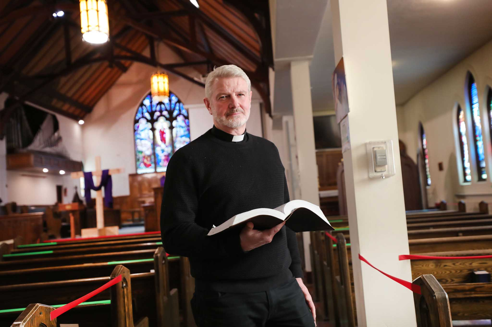 Rev. David Labdon, with St. Aiden's Anglican Church, prepping for in-person Good Friday services. (Ruth Bonneville / Winnipeg Free Press)