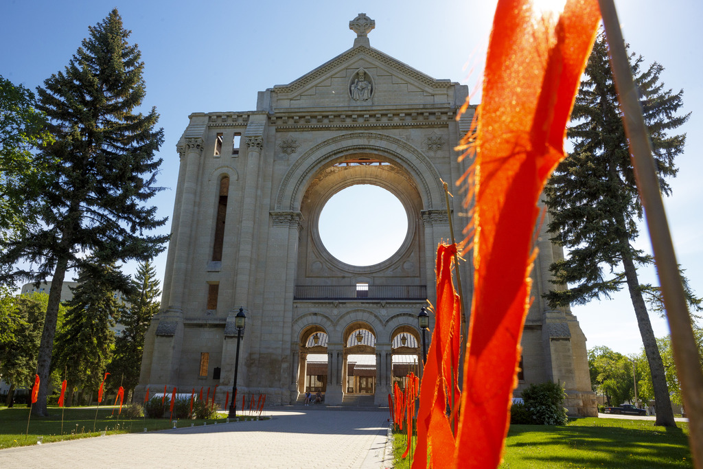 Two-hundred and fifteen orange ribbons line the path to the old St. Boniface Cathedral in June, a memorial to the 215 children found buried in an unmarked gravesite at the former Kamloops Indian Residential School in B.C. (Mike Deal / Winnipeg Free Press files)