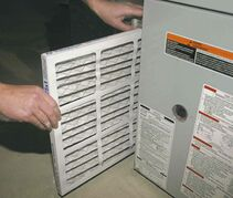 Pulling a furnace filter out of the slot in the return air ducting and replacing it with a new one is a simple task.