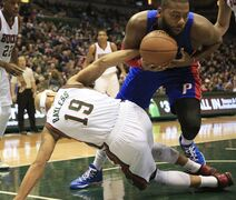 Detroit Pistons forward Greg Monroe, right, battles for the ball with Milwaukee Bucks guard Jerryd Bayless, left, during the first half of an NBA basketball game Saturday, Jan. 24, 2015, in Milwaukee. (AP Photo/Darren Hauck)