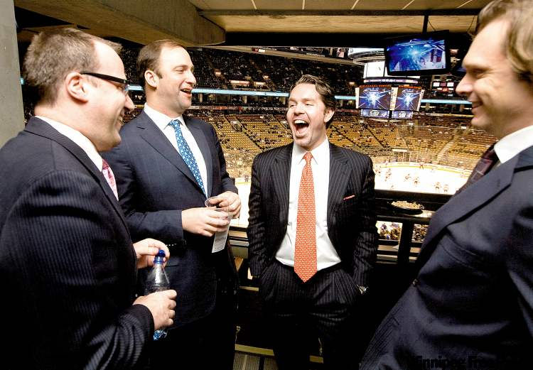 Ice Edge Holdings' braintrust enjoy a light moment at a Phoenix Coyotes-Toronto Maple Leafs game at the Air Canada Centre in Toronto in December 2009. From left: Anthony LeBlanc, chief executive officer; Daryl Jones, chief operating officer; Keith McCullough, chairman; and Todd Jordan, chief financial officer.