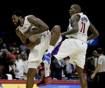 Los Angeles Clippers center DeAndre Jordan, left, and guard Jamal Crawford celebrate during the second half of an NBA basketball game against the Denver Nuggets in Los Angeles, Monday, Jan. 26, 2015. (AP Photo/Chris Carlson)