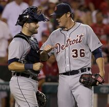 Detroit Tigers relief pitcher Joe Nathan, right, celebrates their 6-4 win with catcher Alex Avila against the Los Angeles Angels during a baseball game in Anaheim, Calif., Thursday, July 24, 2014. (AP Photo/Chris Carlson)