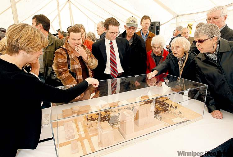 A crowd views a mock-up of the future  Upper Fort Garry heritage park.