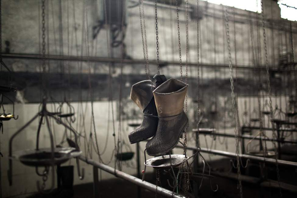 Boots hang in a changing room in the partially abandoned and closed Santiago mine, as a result of the coal crisis, near Mieres, Oviedo, Spain. Spanish coal mining unions are waging a general strike as 8,000 mineworkers at over 40 coal mines in northern Spain continue their protests against government action to cut coal subsidies. (AP Photo/Emilio Morenatti)