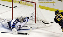Sabres' Tyler Ennis shoots on Ondrej Pavelec during the first period on Monday in Buffalo, N.Y.
