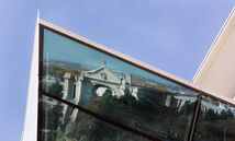 A reflection of the St. Boniface Cathedral reflected in the Canadian Museum for Human Rights.