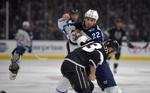 Jets right wing Chris Thorburn scraps with Kings left wing Kyle Clifford.