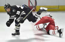 Providence College's Shane Luke (20) leaps over Miami Ohio's Andrew Schmit (33) In the first period of their NCAA east regional hockey tournament game Saturday in Providence, R.I. Luke's father died four years ago, but his spirit lives on as his son prepares for Frozen Four.