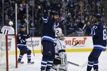 Winnipeg Jets' Andrew Ladd, Bryan Little and Michael Frolik celebrate Ladd's goal against Los Angeles Kings goaltender Jonathan Quick during the second period on Sunday.