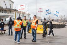 Members of the International Association of Machinists and Aerospace Workers Local 1848 picket at the entrance to the Hudbay Mining and Smelting in Flin Flon.