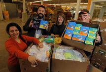 Winnipeg Harvest's Rosa Martinez, Jason Booth, Lauren Rist and Duncan Stokes show off some of 20 boxes of donated products.