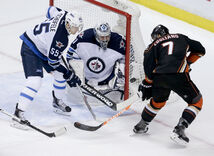 Jets goalie Ondrej Pavelec stymies Ducks center Andrew Cogliano.