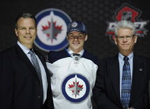 Joshua Morrissey, 13th pick overall in the 2013 NHL draft, stands between Winnipeg Jets GM  Kevin Cheveldayoff (left), and Marcel Comeau, director of amateur scouting.