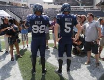 Winnipeg Blue Bombers QB Drew Willy and DE Jason Vega display their new Signature Jersey at Investors Group Field this afternoon. The Signature Jersey will be worn once, at home on Friday against the Alouettes.