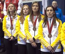 Team Manitoba (from left) skip Chelsea Carey, Kristy McDonald, Kristen Foster and Lindsay Titheridge pose with their bronze medals at the Scotties Tournament of Hearts curling championships February 9, 2014 in Montreal.