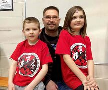 Mark Hnatuk, who attended the inaugural Grade 1 EUBP class 35 years ago, and his children Chase (left) and Reese, who currently attend the EUBP at R.F. Morrison School.