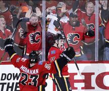 Calgary Flames' Johnny Gaudreau celebrates his late third period goal against the Anaheim Ducks to tie the game during NHL playoff action in Calgary, Alta., Tuesday, May 5, 2015. THE CANADIAN PRESS/Larry MacDougal