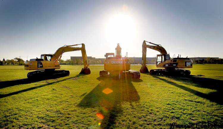 Excavators await the official start of the construction Thursday morning.