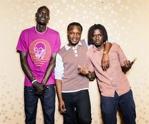 In this Monday, Sept. 29, 2014 photo, Ger Duany, Arnold Oceng, and Emmanuel Jal pose for a portrait during press day for