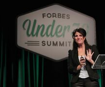 Monica Lewinsky waves goodbye to the crowd after her speech at the Forbes Under 30 Summit.