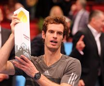 Andy Murray of Britain holds the trophy after winning teh final match against David Ferrer of Spain at the Erste Bank Open tennis tournament in Vienna, Austria, Sunday, Oct. 19. 2014. (AP Photo/Ronald Zak)