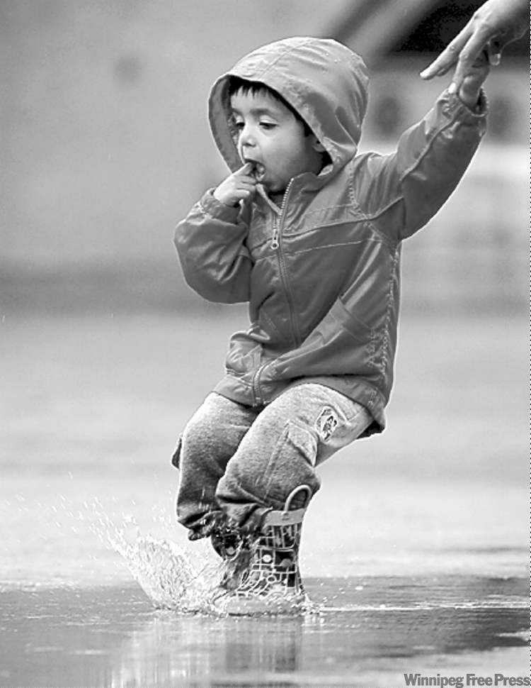MIKE.DEAL@FREEPRESS.MB.CAAjai Sandhu, 2, jumps in puddles  at The Forks on Friday.