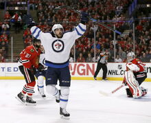 Winnipeg Jets center Mathieu Perreault celebrates after scoring on the Chicago Blackhawks on Tuesday in Chicago.