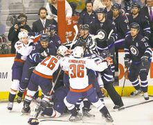 Things got just a little wild when Washington's Mattieu Perreault slashed Winnipeg's Zach Bogosian, who took exception to the two-hander. Those two players are somewhere in the middle of the scrum.