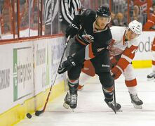 Carolina's Michal Jordan (47) battles Detroit's Gustav Nyquist  for the puck during a recent game in Raleigh, N.C.