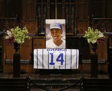 A large photograph is diplayed behind the casket of Chicago Cubs Hall of Famer Ernie Banks, during a public visitation held for Banks who died after a heart attack last week, Friday, Jan. 30, 2015, in Chicago.