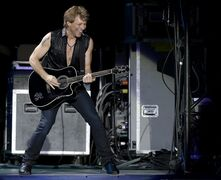 FILE - In this June 26, 2014, file photo musician Jon Bon Jovi performs during a concert of the American rock band Bon Jovi in Lisbon, Portugal. Bon Jovi is part of a Toronto group that has retained a banking firm and submitted paperwork expressing interest in buying the Buffalo Bills, three people who have reviewed documents regarding the sale process told The Associated Press on Friday, July 18, 2014. (AP Photo/Armando Franca, File)