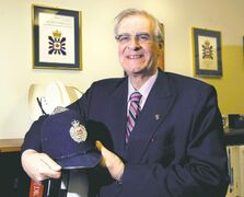 Graham Starmer with his  bobby's hat. The Manitoba Chambers of Commerce president spent the first 27 years of his working life as a police officer and spy catcher in England and Canada.