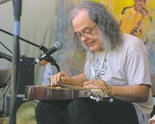 David Lindley plays a multitude of stringed instruments from around the globe.