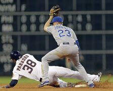 Houston Astros right fielder Jimmy Paredes (38) is picked off at second base as Kansas City Royals shortstop Elliot Johnson (23) applies the tag in the sixth inning during a baseball game, Tuesday, May 21, 2013, in Houston. (AP Photo/Bob Levey)