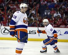 New York Islanders center Ryan Strome (18) celebrates his goal with center John Tavares (91) nearby, during the second period against the Washington Capitals in Game 2 of a first-round NHL hockey playoff series, Friday, April 17, 2015, in Washington. (AP Photo/Alex Brandon)