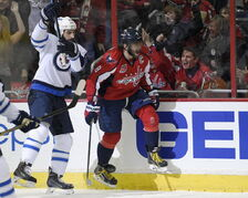 Washington Capitals left wing Alex Ovechkin right celebrates his goal next to Winnipeg Jets right wing Chris Thorburn during the first period of Thursday's game.