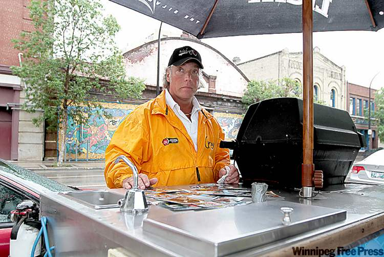 Darryl Leiman with his new hotdog cart at Old Market Square after a crash wiped out his iconic truck.
